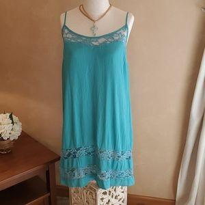 Beautiful teal/aqua dress with lace detail.